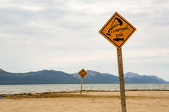 Kiteboarding, wooden kite surfing sign on beach. Kiteboarding sign, wooden kitesurfing signpost on a beach at adriatic sea in Croatia. Inspiring kitesurfer Stock Image
