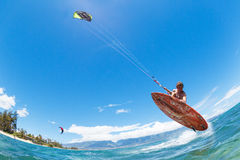 Kiteboarding. Young Man KiteBoarding, Fun in the ocean, Extreme Sport Kitesurfing Royalty Free Stock Photography
