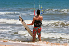 Kiter. Looking at his kite ready to go for a ride on the waves Stock Photo