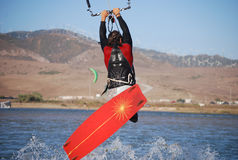 Kiter flying on the waves near Tarifa, Spain. Kiter flying over a lagoon near Tarifa, Spain Stock Photography