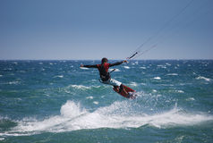Kiter flying on the waves near Tarifa, Spain Royalty Free Stock Image