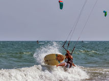 Kiter jumping from wave to wave Stock Photos