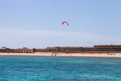 Kiter in the lagoon of the Red Sea on the background of an unfin Stock Image