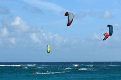 Kiters day out. A group of kite surfers out riding in clear, easy conditions stock photography