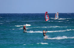 Kiters day out. A group of kite surfers and windsurfers out riding stock image