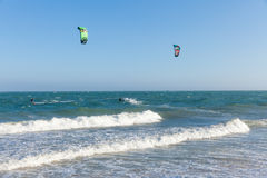Kiters ride on the waves at Mui Ne beach, Royalty Free Stock Image