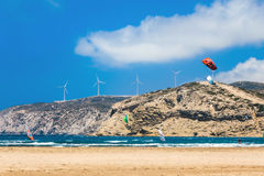 Kiters and windsurfers in the Gulf of Prasonisi. Rhodes Island. Prasonisi confluence of the Aegean and Mediterranean seas. The place for windsurfers and Royalty Free Stock Photo