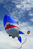 Kites. Kite in the sky - a big kite in the shape of a shark Royalty Free Stock Photo