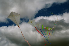 Kites. Colorful kite flying in an ominous sky Stock Image