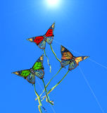 Kites. Three colorful kites at sunny sky Royalty Free Stock Images