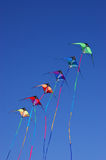 Kites against blue sky Royalty Free Stock Images