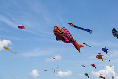 Kites against a blue sky Stock Photo