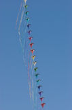 Kites against a vivid blue sky Royalty Free Stock Images