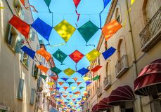 Kites as street decoration in Ceret, Roussillon France royalty free stock photo