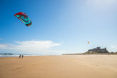 Kites on the beach at Bamburgh castle Stock Images