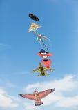 Kites. Beach umbrella in summer with flying kites Royalty Free Stock Photo