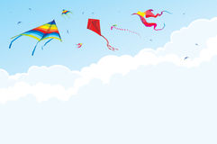 Kites and birds on the background of sky and clouds Stock Photo