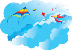 Kites and birds on the background of sky and clouds Stock Image
