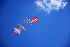 Kites on blue sky. Colorful kites shot agains a deep blue sky Royalty Free Stock Images
