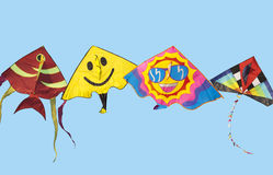 Kites in blue sky. Happy kites with face and glasses shown summer suny day stock photos