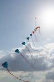 Kites on blue sky Stock Photography