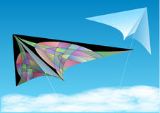 Kites in blue sky Stock Images