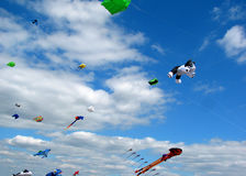 Kites in a bright blue sky Stock Photo