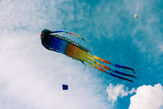 Kites of different shapes in the cloudy sky royalty free stock image