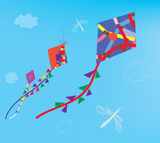Kites and dragonfly in the sky Royalty Free Stock Photo