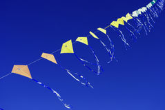 Kites flying. Kites with blue sky background Royalty Free Stock Photography