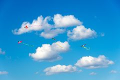 Kites flying in the sky, fun and exciting for children. Concept of dreaming or active summer holiday. Kites flying in the sky, fun and exciting for children Stock Image