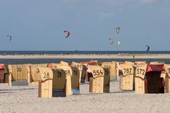 Kites over Laboe. Looking over the Strandkorbe to the kite surfers in Laboe Stock Photo