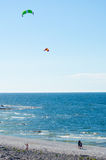 Kites. People flying kites on the beach on a windy day Royalty Free Stock Photography