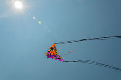 Kites in the sky. Colorful kite soaring against blue sky. Summer Kite Festival, Canal Days International Kite Show in  City of Port Colborne, Ontario, Canada Stock Photo