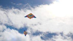 Kites in the sky. Colorful kites flying in blue sky. Under the blue sky flying kites. 4K stock video