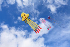 Kites in the Sky. Three kites flying in the blue sky Stock Image