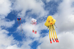 Kites in the Sky. Three kites flying in the blue sky Royalty Free Stock Photo