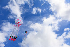 Kites in the Sky. Two kites flying in the blue sky Stock Photos