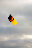 Kitesurf. Colorful kite in a dark, gloomy sky Royalty Free Stock Photography