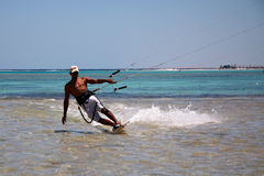 Kitesurfer. Unidentified man kitesurfing in Red Sea waters in Egypt, Sharm-El-Sheikh on April 24, 2010 Stock Image