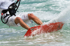 Kitesurfer. A lot of spray of a kitesurfer Royalty Free Stock Photo