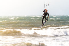 Kitesurfer in action. OVAR, PORTUGAL - APRIL 30, 2016: Kitesurfer in action at Furadouro beach in Ovar, Portugal, known as one of the best kitesurfing spots in Stock Photos