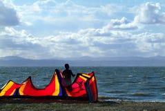 Kitesurfer on the beach Royalty Free Stock Photo