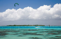 Kitesurfer on a blue lagoon Stock Images