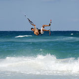 Kitesurfer in the Caribbean. A kitesurfer jumps waves in Caribbean stock photos