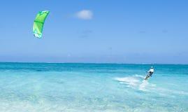 Kitesurfer on clear blue tropical lagoon water, Okinawa, Japan. Man enjoying kitesurfing on clear blue tropical sea, Kume Island, Okinawa, Japan Royalty Free Stock Image