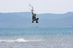 Kitesurfer doing a trick Royalty Free Stock Photography