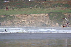 Kitesurfer em areias de Saunton Fotografia de Stock Royalty Free