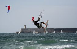 Kitesurfer flying. With national flag on the board Stock Photo