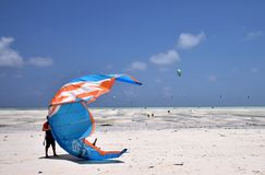 Tanzania, Zanzibar - February 4, 2018. Kitesurfers on Paje Beach stock photos